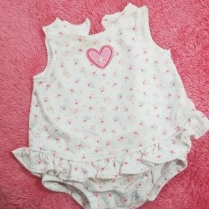 A beautiful 3 month Carter  Baby girl one piece